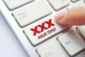 Finger pressing adult only button — Stock Photo