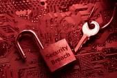 Security lock on computer circuit board — Stock Photo