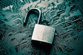 Unlock security lock on circuit board — Stock Photo