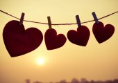 Silhouette of hearts hanging on rope — Stock Photo