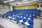 Lecture chairs in a class room — Stock Photo