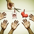 Hand with scissors trying to cut a rope — Stock Photo #78507236