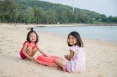 Happy smile asian kids girl - Thai child playing sand on the bea — Stock Photo