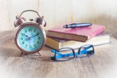 Pocket watch and glasses — Stock Photo