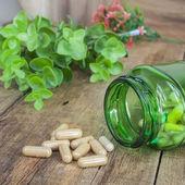 Herb capsules — Stock Photo