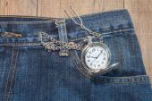 Pocket watch in pocket of jeans — Stock Photo