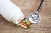 Stethoscope and Capsule pills — Stock Photo