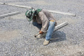 Builder man working with hammer — Stock Photo