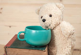 Bear toy with cup of coffee — Stock Photo