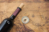 Bottle of wine  on the background of old maps — Stock Photo