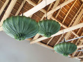 Modern design wooden ceiling. Green chandeliers in the shape of  — Stock Photo
