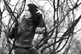 Woman in warm clothes positng outdoors. Black and white photo. — Stock Photo