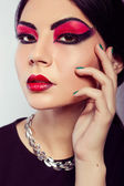 Fashion model portrait. Scarlet makeup. Black arrows. — Stock Photo