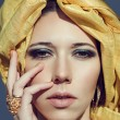 Постер, плакат: Arab girl in turban Gold jewelry Makeup smoky turquoise eyes
