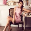 Young beautiful woman in pink dress. Fashion model shooting. — Stock Photo #62285437