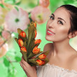 Spring model shooting. Young woman with flowers tulips on background blooming garden. Fashion fresh natural makeup.  Sensual scarlet lips. Perfect skin. Tenderness. Romantic style. Enjoy life — Stock Photo #64740053