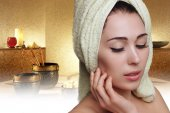 Young beautiful woman in white towel turban on spa background after bath touching her face. Skin care. Beauty and health. Spa treatment. Clear perfect skin. Relax. Massage. — Stock Photo
