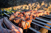 Shish kebab on the grill with smoke — Stock Photo