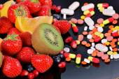 Berries, fruits, vitamins and nutritional supplements  — Foto de Stock