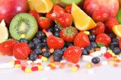Berries, fruits, vitamins and nutritional supplements  — Photo