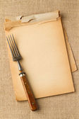 Old fork and yellowed notebook — Stock Photo