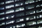 Office windows in the night — Stock Photo