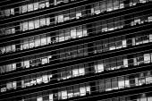 Office windows in the night. Black and white version — Stock Photo