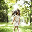 Beautiful girl jumping smiling in the park — Stock Photo #63662835