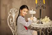 Beautiful Little girl sitting and going to eat cakes — Stock Photo