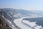 Winter landscape with frozen river — Stock Photo