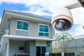 CCTV Camera or surveillance operating with house village in back — Stock fotografie