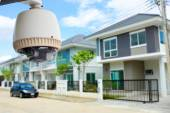 CCTV Camera or surveillance operating with village in background — Stock Photo