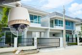 CCTV Camera or surveillance operating with house village in back — Stock Photo