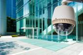 CCTV Camera or surveillance orperating with city building in bac — Stock Photo