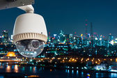 CCTV Camera or surveilance Operating with city in background — Stock Photo