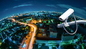 CCTV with Blur City in background fish eye perspective — Stock Photo
