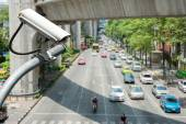 CCTV camera or surveillance operating on traffic road — Stock Photo