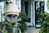 CCTV camera or surveillance operating on building entrance — Stock Photo