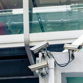 CCTV camera or surveillance operating in city — Stock Photo