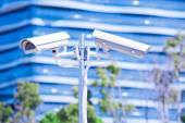 CCTV camera or surveillance operaiting with blue building in bac — Stock Photo