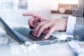 Close up of business man typing on laptop conputer with technolo — Stock Photo