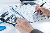Businessman using calculator analyze report — Stock Photo