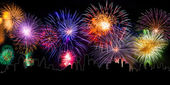 Colorful fireworks with cityline — Stock Photo