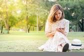 Young woman using tablet in park — Stock Photo