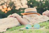 Fasion sun glasses with young woman sleeping in background, vint — Stock Photo