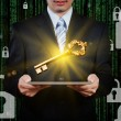 Businessman using tablet with gold key, security concept — Stock Photo #68385941