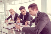 Business partners discussing documents and ideas at meeting — Stock Photo