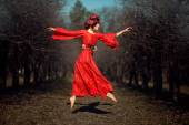 Girl in red dress soars. — Stock Photo