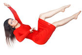 The girl in the red dress soars. — Stock Photo