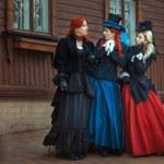 Three girls in retro dresses. — Stock Photo #63584629